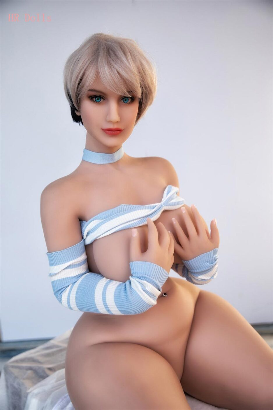 Big breasted sex doll with hands on chest
