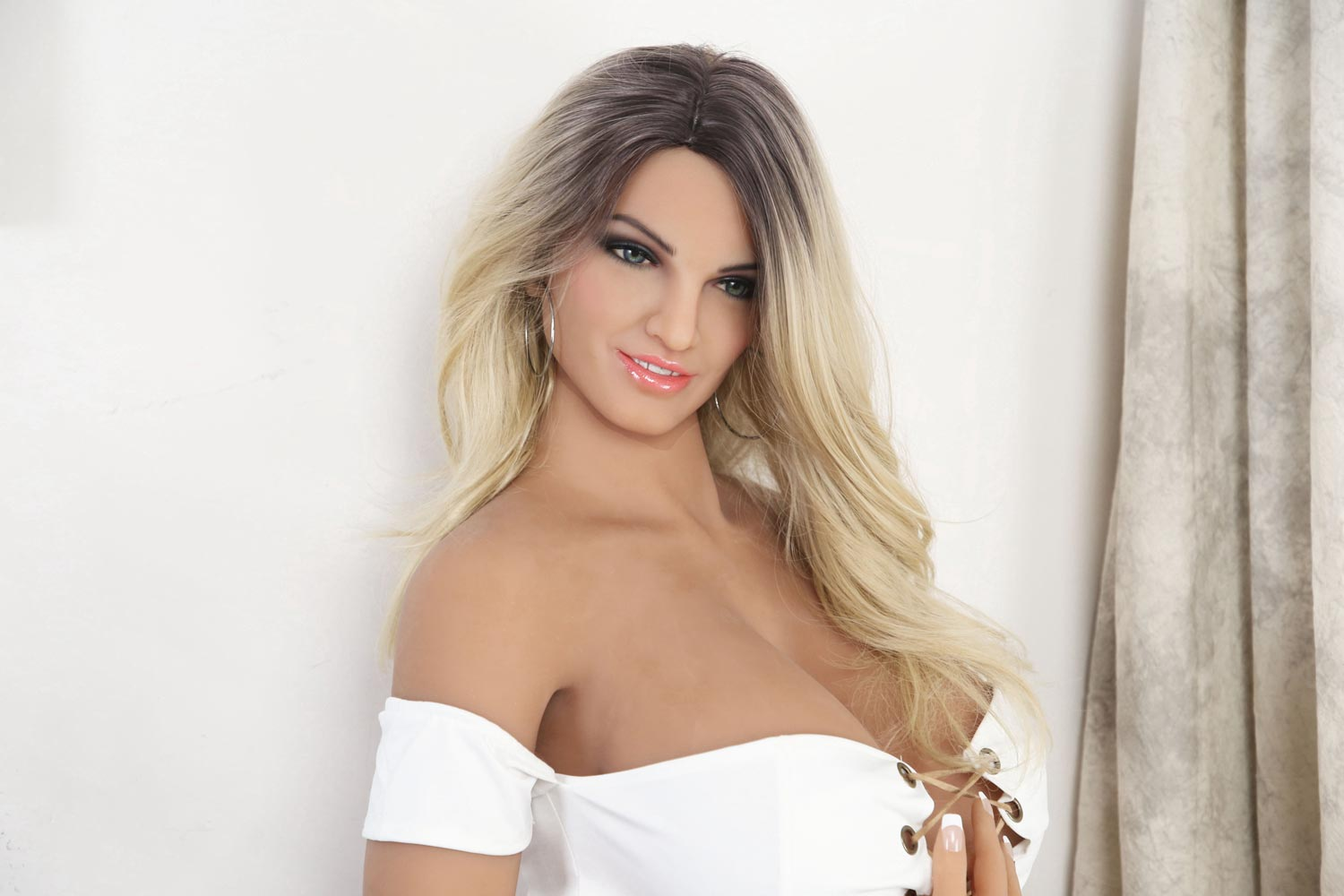 Big breasted sex doll with hands on clothes