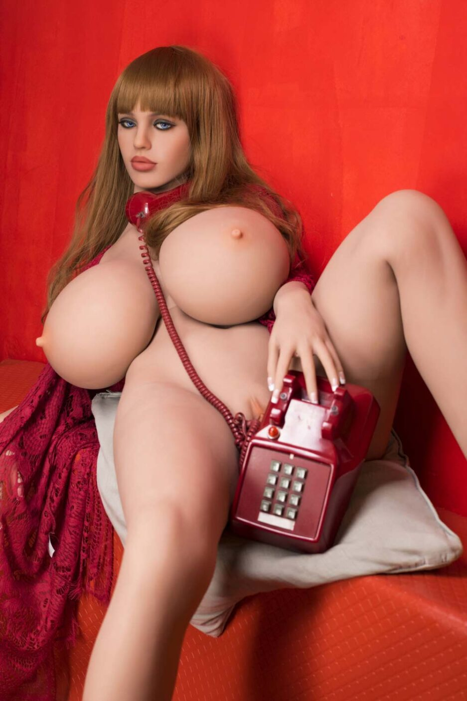Big breasted sex doll with hands on the phone