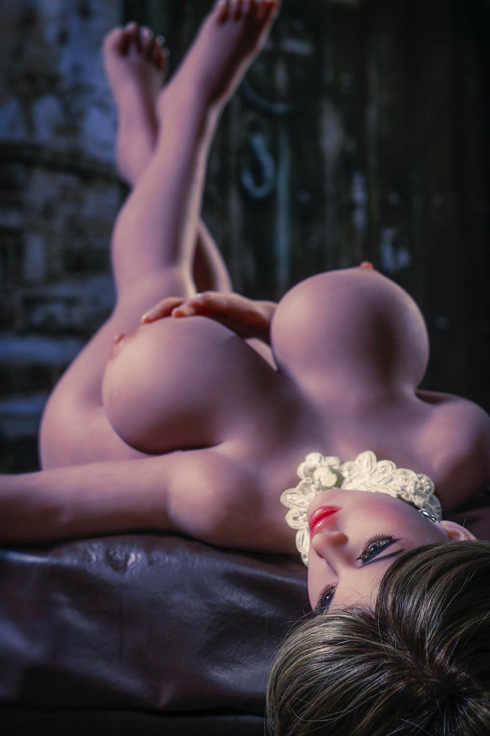 Big breasted sex doll with legs raised