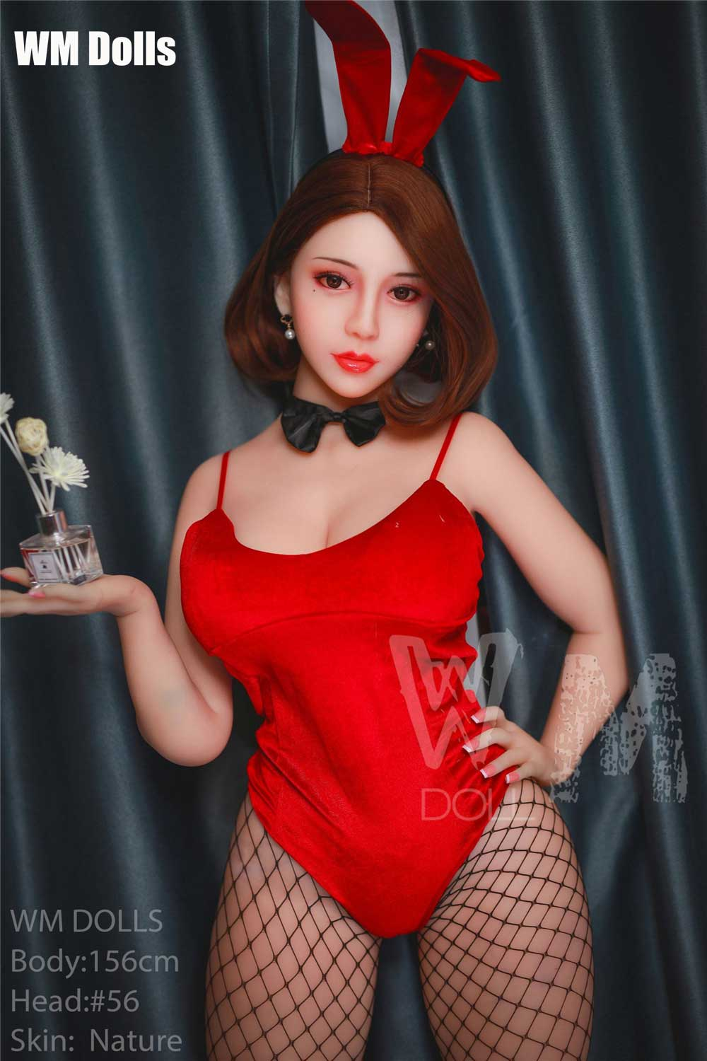 Big breasted sex doll with one hand on hips