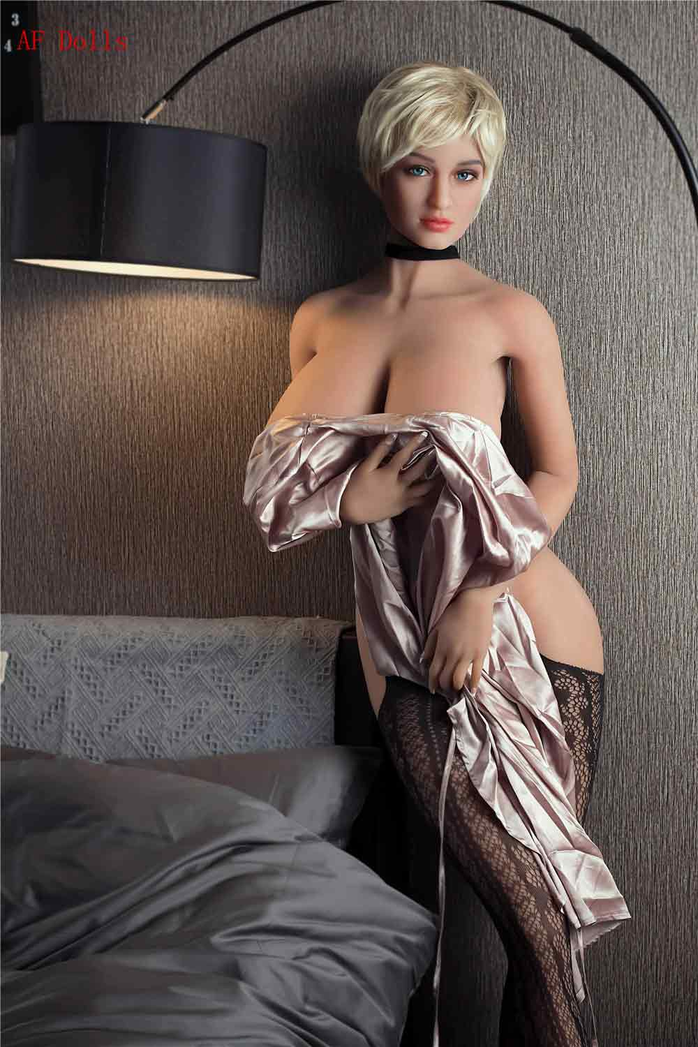 Big breasted sex doll with pajamas taken off