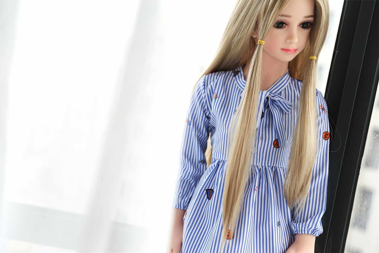 Mini sex doll by the window