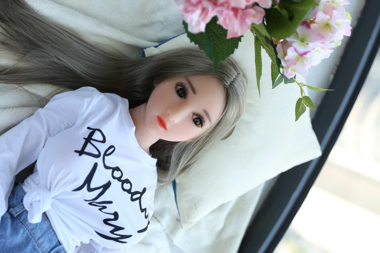Mini sex doll in white clothes