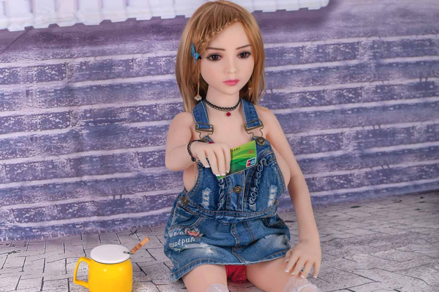Mini sex doll with bank card in hand