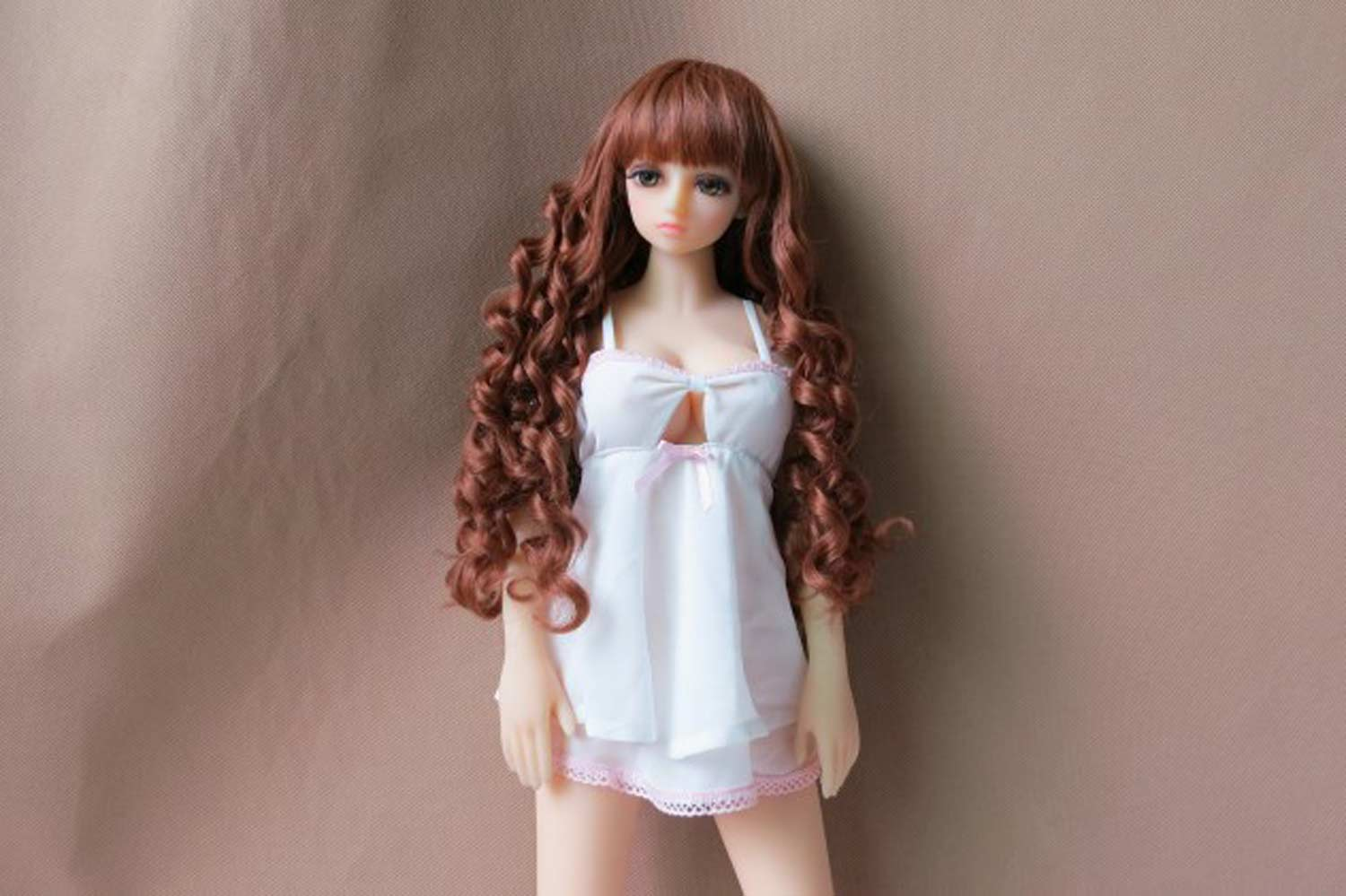 Mini sex doll with brown curly hair