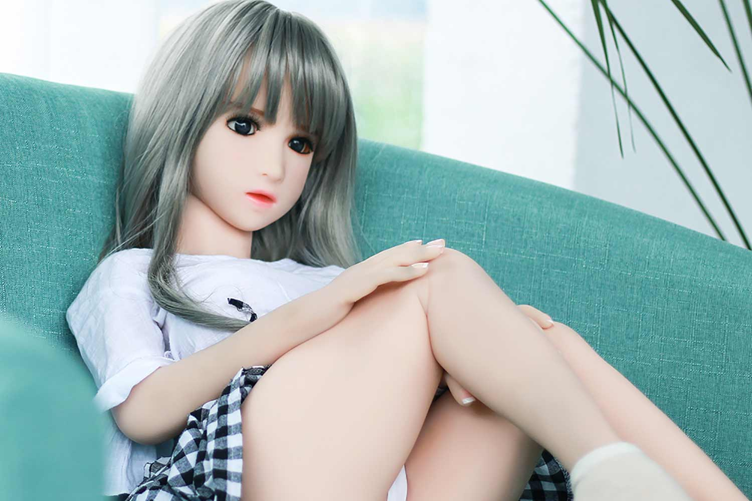 Mini sex doll with hand on thigh