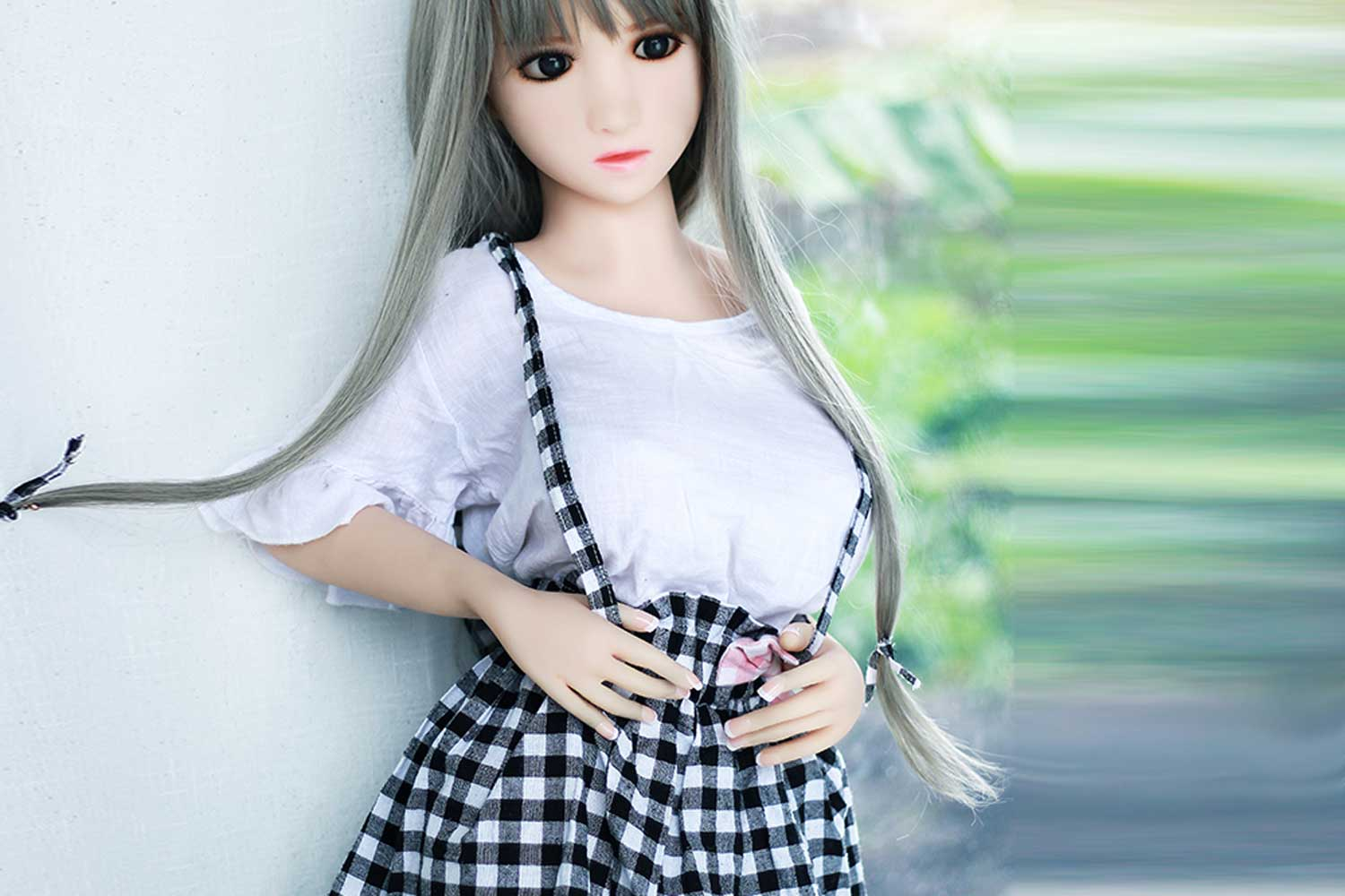 Mini sex doll with hand strap