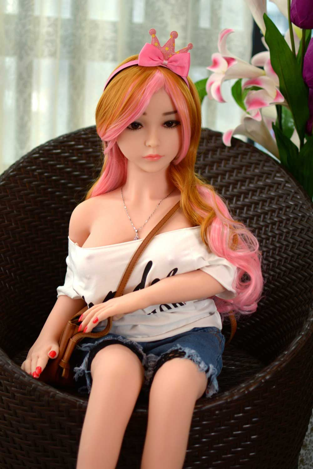 Mini sex doll with hands on the bag