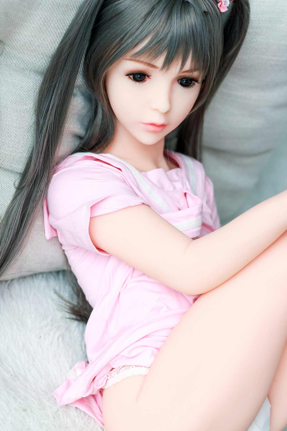 Mini sex doll with hands on thighs