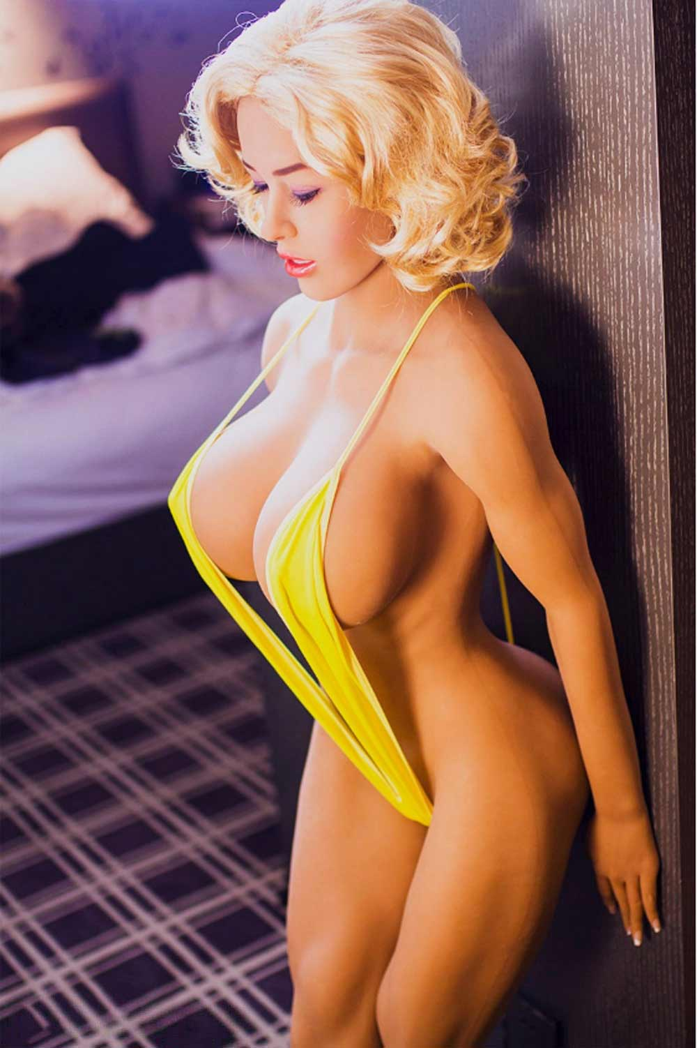 Sex-doll-leaning-against-the-wall