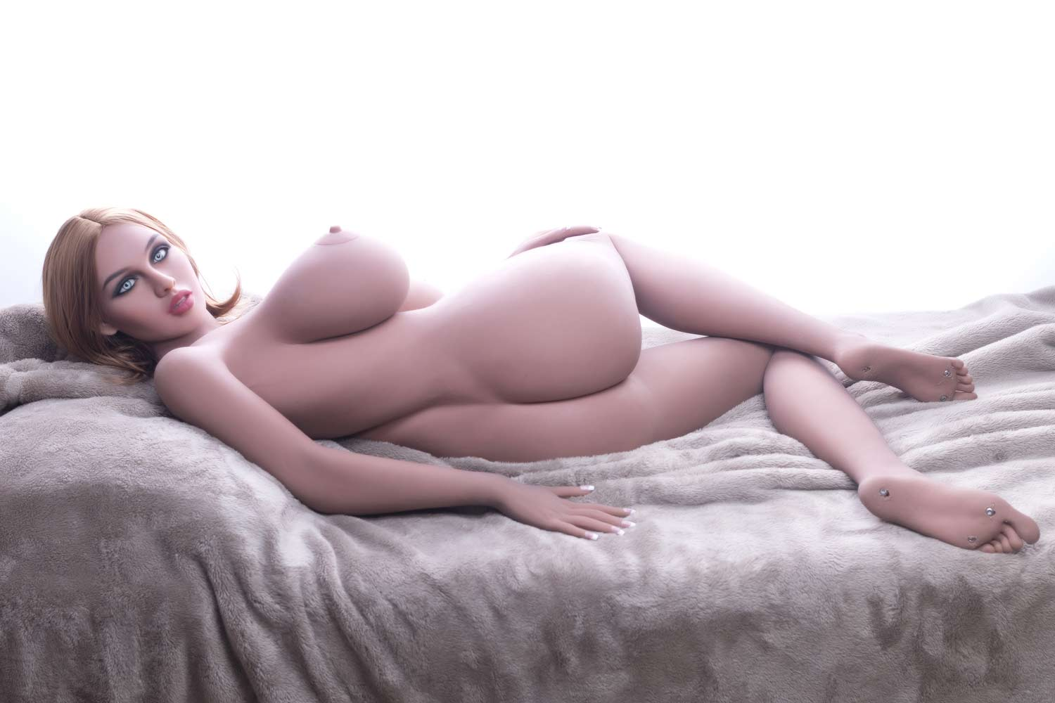 Sex doll lying naked on the side