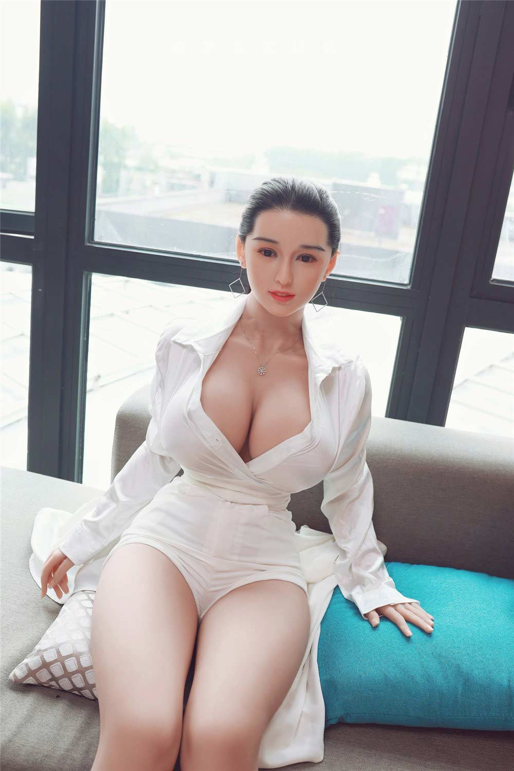 Sex doll sitting on pillow