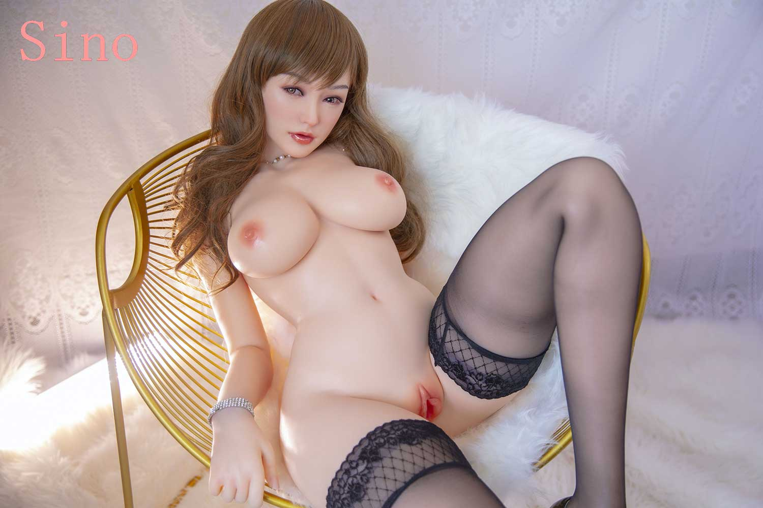 Silicone sex doll sitting on a chair