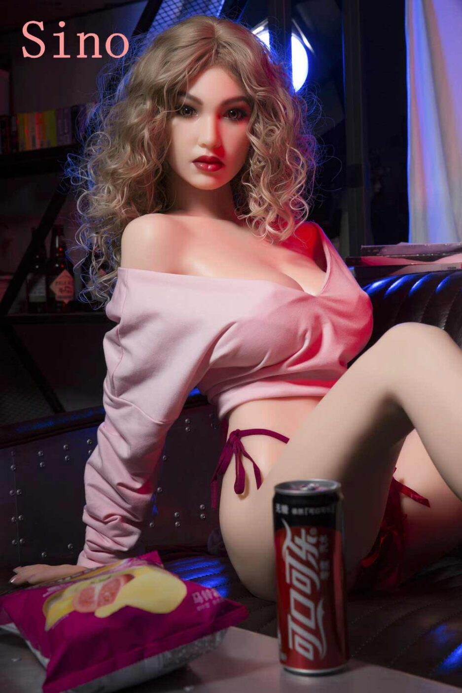 Silicone sex doll with Coke next to it