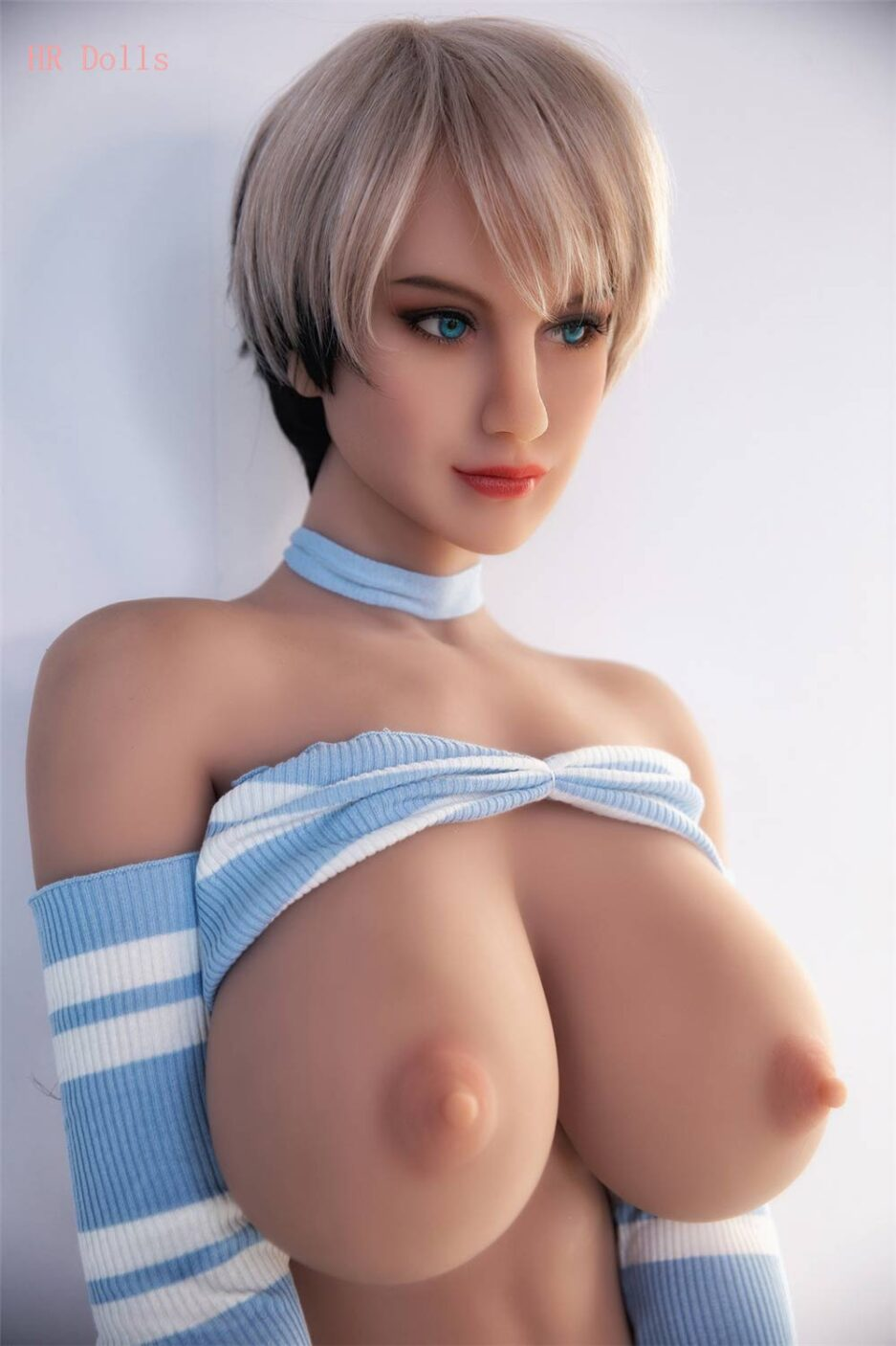 Yellow-haired busty sex doll