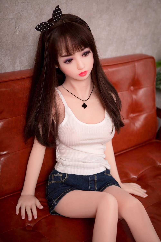 Mini sex doll in a white vest