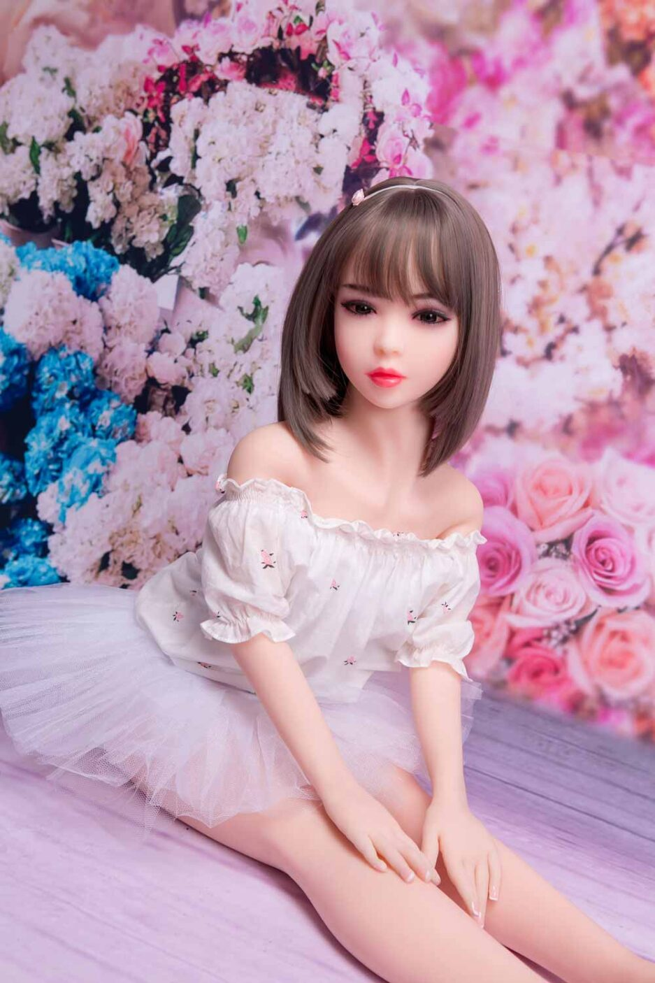 Mini sex doll in white skirt