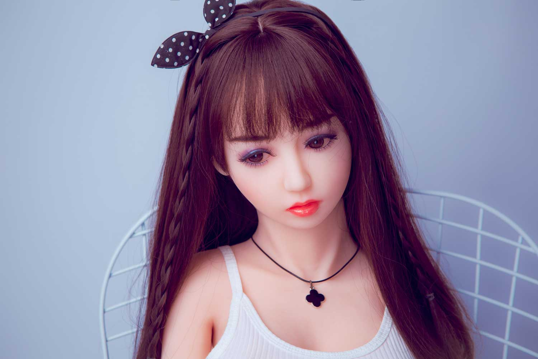 Mini sex doll wearing a leaf headband