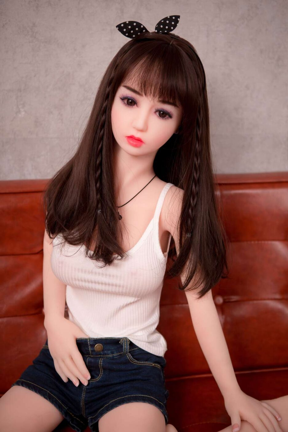 Mini sex doll with hands in denim shorts