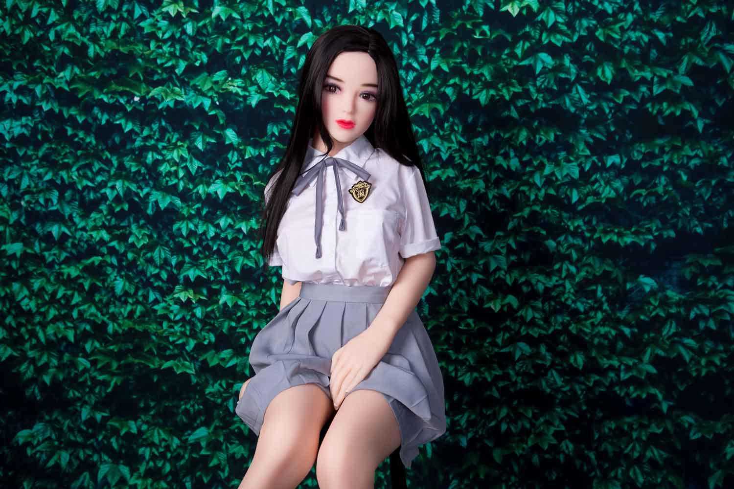 Mini sex doll with hands on skirt