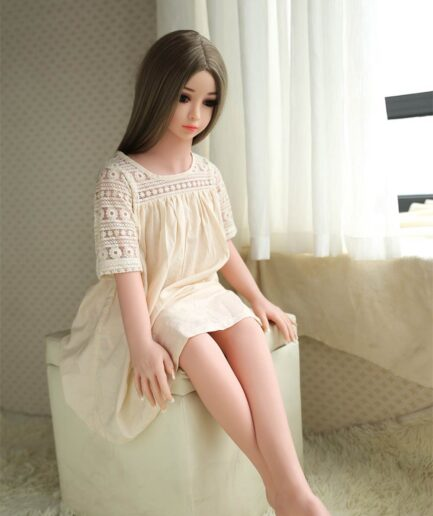 Mini sex doll with hands on the stool