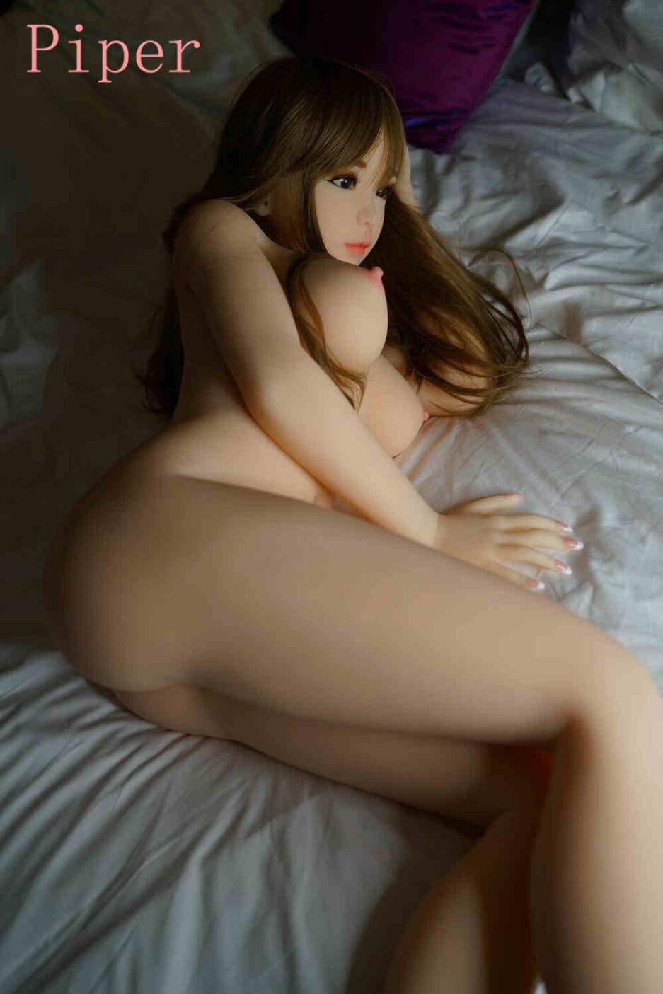 Sex doll lying sideways on the bed