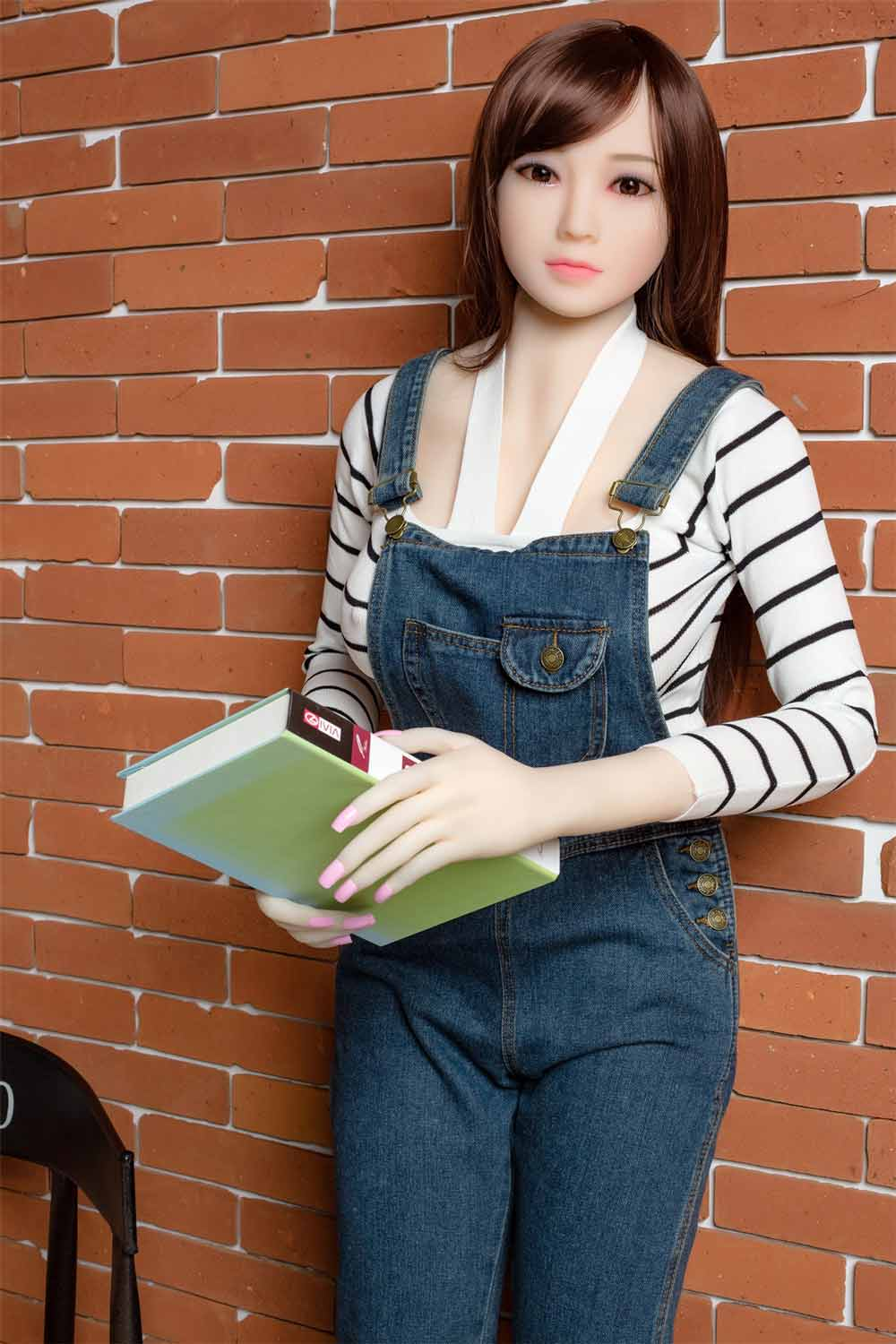 Sex doll with book in both hands