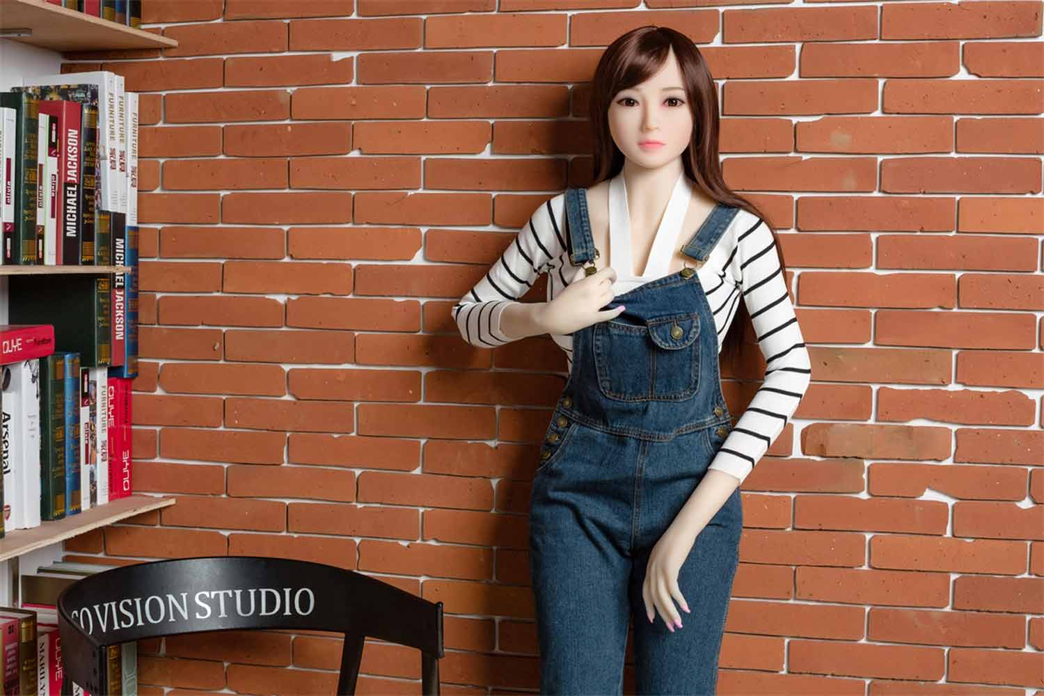 Sex doll with hand drawn denim jumpsuit