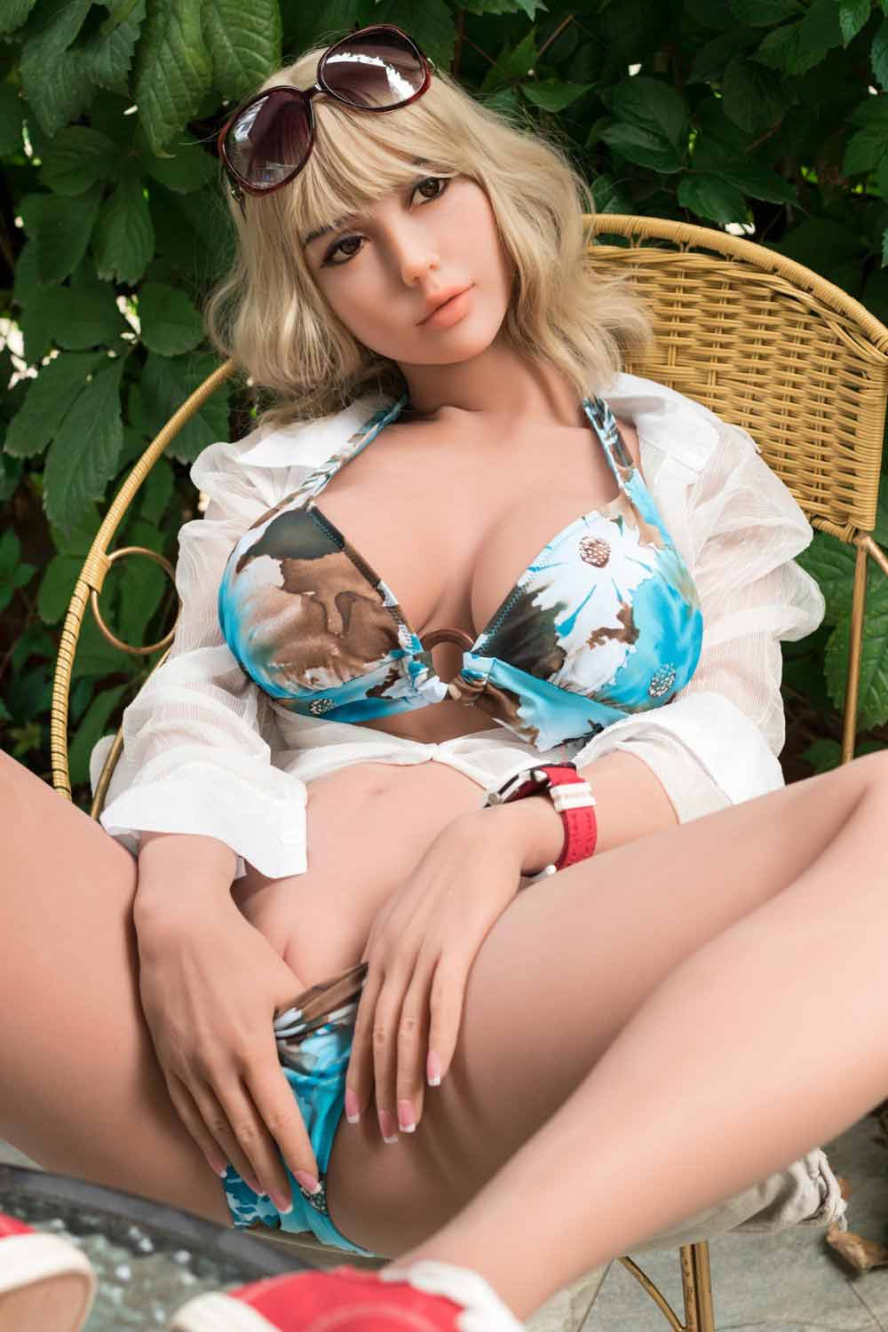 Sex doll with hands between thighs