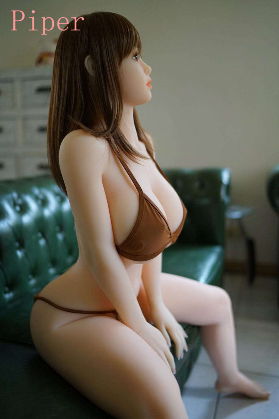 Sex doll with hands on the sofa