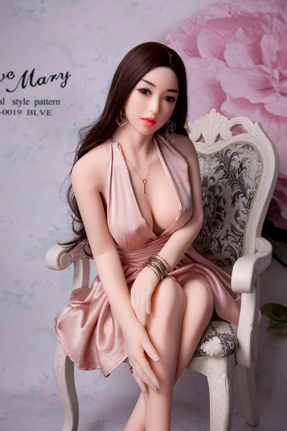 Sex doll with hands touching calves
