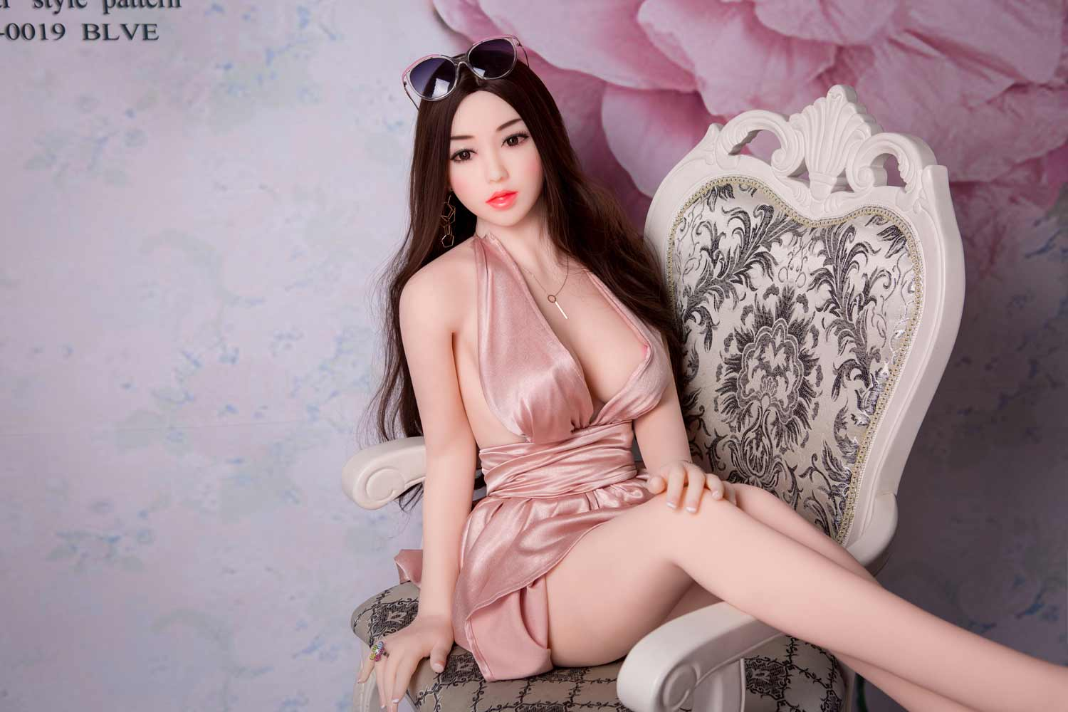 Sex doll with legs on the arm of the chair