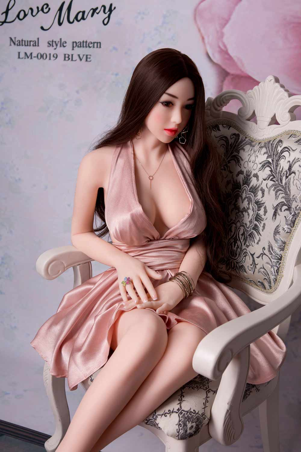 Sex doll with ring in hand