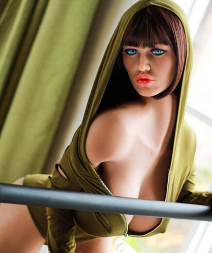 Shemale sex doll holding on to the railing with both hands