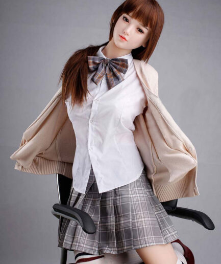 Anime sex doll with legs kneeling on a chair