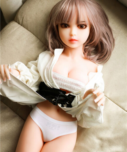 A mini sex doll that pulls up the corners of her clothes to reveal her underwear