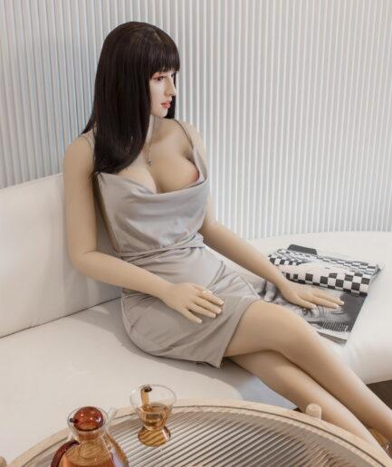 beautiful Chinese sex doll sitting